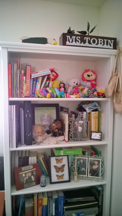 Finished bookshelf.  It is hard to see the wallpapered background currently, but once it is filled with baby books and toys hopefully it will be more visible.